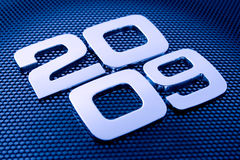 Metal digits - 2009. & technology background Stock Images