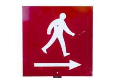 Metal directional sign, with white painted figure walking, a Stock Photo