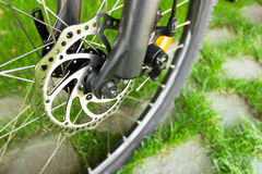 Metal disc brake detail on mountain bicycle Royalty Free Stock Photo