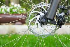 Metal disc brake detail on mountain bicycle Royalty Free Stock Image