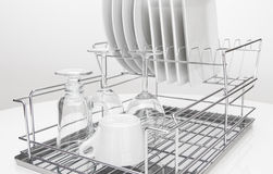 Metal dish rack with dishes and glasses Stock Photography