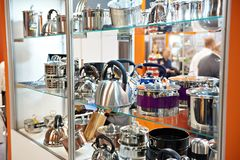 Metal dishes, pots and kettles in store. Metal dishes, pots and kettles on the counter in the store Royalty Free Stock Photography