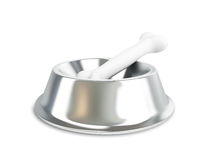 Metal dog dish and bone. On a white background Royalty Free Stock Photos