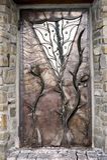 Metal door. The door made of metal with floral ornametns Royalty Free Stock Photo