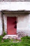 Metal door in an abandoned house. stock photo