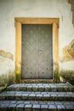 Metal door in an ancient fortress Stock Image