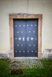 Metal door in an ancient fortress Stock Photography