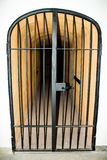 Metal door with bars in a prison Stock Image