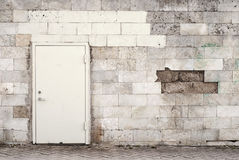 Metal door and brik wall Stock Image