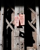 Metal door with Chinese label. Close up picture of Metal door with Chinese label. Light and shadow Royalty Free Stock Photo