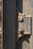 Metal Door Detail. Detail of the latch, lock and knob area of a metal door.  Knob is missing Royalty Free Stock Photos