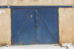 Metal door of garage with lock. brick background Royalty Free Stock Photos