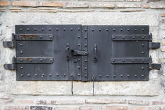 Metal Door gate on brick wall Stock Images