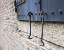 Metal Door gate Hook details with brick wall. Perspective Royalty Free Stock Image