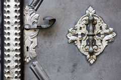 Metal door handle. Door-handle decoration detail of old metal iron entrance door in Prague Little quarter Stock Image