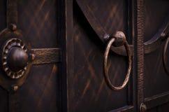 Metal door handle forged gate stock photo