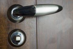 The metal door handle. Stock Image