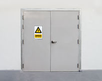 Metal door. High Voltage Sign on Metal door stock image