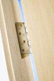 Metal door hinge on wooden door royalty free stock image