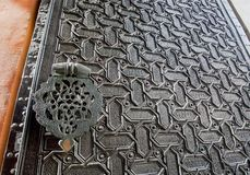 Metal door with islamic patterns and Arabic calligraphy of the 16th centure Seville Cathedral, Spain. Motifs in artworks of Andalusia stock photography