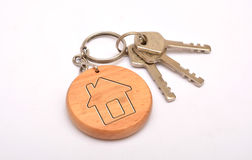 Metal door keys with house-shape key ring isolated on white background Stock Photos