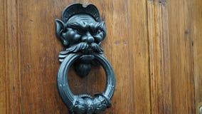 Metal door knocker. In the shape of a demon Stock Photos