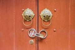 Metal door knockers and lock Royalty Free Stock Photography