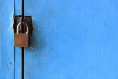 Metal door lock Blue room background Stock Photo