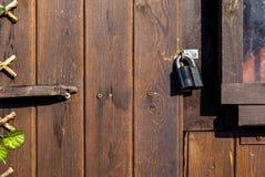 Metal door lock on a brown background dark Royalty Free Stock Image