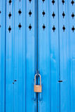 Metal door with lock. Closed metal door with lock at front home Royalty Free Stock Image