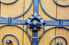 Metal door lock. Metal fittings on ancient medieval wooden door Stock Image