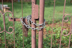 Metal door locked with a chain. Close-up of metal door locked with a chain Stock Photography