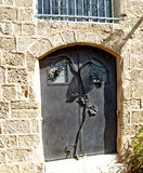 Metal door with ornament in the form of a grapevine. Yaffo, Israel Stock Images