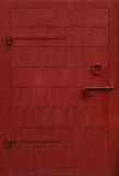 Metal door with rivets Royalty Free Stock Image