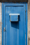Metal door rusty with mail box. Blue color metal door rusty with mail box Stock Photography
