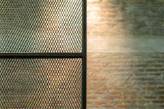 Metal door see brick wall background Stock Photo