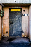 Metal Door to Concrete Bunker for Explosives. Stock Photo