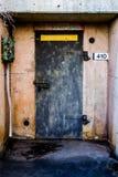 Metal Door to Concrete Bunker for Explosives. Stock Photo