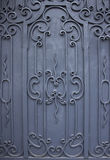 Metal door. With wrought iron ornaments twisted Stock Images