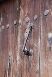 Metal Doorknob on Wooden Door Stock Images