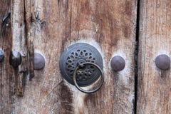 Metal Doorknob on Wooden Door Royalty Free Stock Images
