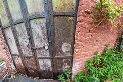 Metal doors, brick wall Stock Images