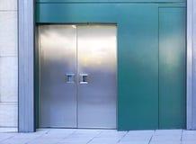 Metal doors. Double metal doors at industril building Stock Images