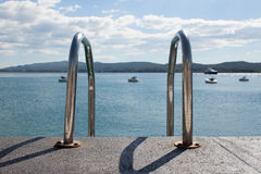 Metal drabina przy morzem Obrazy Royalty Free