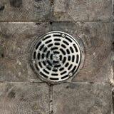 Metal drain cover Royalty Free Stock Photos