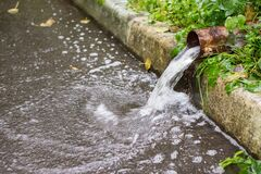 Free Metal Drain Or Gutter Pipe During Heavy Rain Shower Royalty Free Stock Image - 196016526
