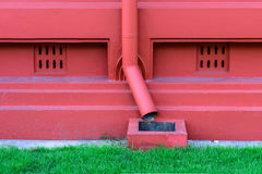 Metal drainpipe in red color Royalty Free Stock Photos