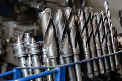 Metal drill bits on a stand. In a workshop Stock Photos