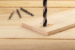 Drill bits on wooden table,diy at home concept royalty free stock photo