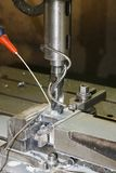 Metal drill press. A metal drill press at work Stock Photos